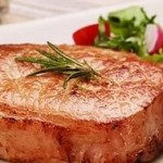 Chops from pork in breadcrumbs with a soft creamy pear sauce