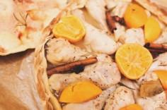 Chicken drumsticks with a tangerine