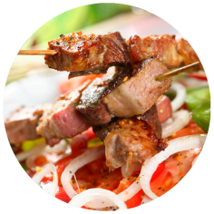 "Classic barbecue pork with sauce ""satsebeli"" and a salad of grilled vegetables"
